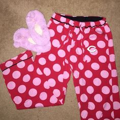 """⚾️Cincinnati Reds pajama pants & slippers Cincinnati Reds pajama pants. Red pants with pink polka dots. Has the Reds emblem on the left upper thigh. Says """"REDS"""" on the back side. Size M. Worn only a few times. Fuzzy pink slippers size S/M Sideline Apparel  Intimates & Sleepwear Pajamas"""