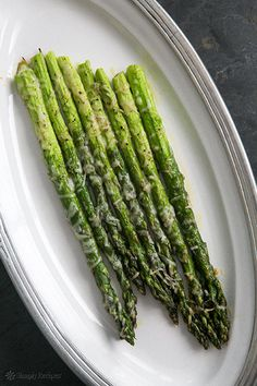 Baked Asparagus with Parmesan Recipe Simplicity is the key for this one! The Parm and EVOO compliment this delicious veggie! 4.5 of 5 stars!