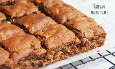 Everyone will go nuts for this dairy-free date and walnut slice. It's quick, easy and totally delicious. Tray Bake Recipes, Baking Recipes, Dessert Recipes, Desserts, Dinner Recipes, Walnut Cookie Recipes, Walnut Cookies, Date Slice, Date And Walnut Loaf