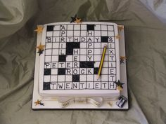 http://confectionperfection.co.uk/images/made/site/uploads/gallery/Bespoke%20Cakes/Men/hb11.105_crossword_cake_700_525.JPG