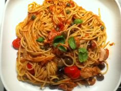 Spaghetti with tuna fish, calamata olives, cherry tomatoes, cappers and a bit of ginger root and basilicum !!! Very tasty!!