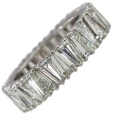 Triangle Cut Diamond Eternity Band | From a unique collection of vintage band rings at https://www.1stdibs.com/jewelry/rings/band-rings/