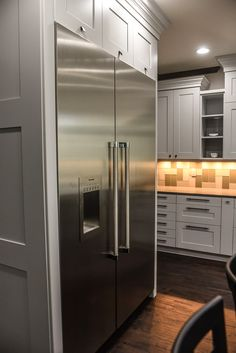 Custom-made refrigerator cabinets and shaker style panels made by Doors Your Way