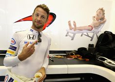Jenson Button Photos Photos - Jenson Button of Great Britain and McLaren Honda in the garage before the Abu Dhabi Formula One Grand Prix at Yas Marina Circuit on November 27, 2016 in Abu Dhabi, United Arab Emirates. - F1 Grand Prix of Abu Dhabi