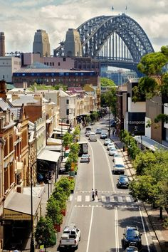 On your travels to Sydney, NSW, Australia makes sure to check out the historical district called 'The Rocks'. You will also be able to see the Sydney Harbour Bridge as well as the Sydney Opera House from here. Click the image to read our post for more i Australia Tourism, Visit Australia, Sidney Australia, Western Australia, South Australia, Queensland Australia, Airlie Beach, Harbor Bridge, Sydney Harbour Bridge