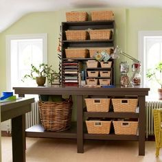 Large baskets hold books, magazines, and bulky supplies. A smaller shelving unit atop the table houses several smaller baskets for paper and writing utensils. A magnetic strip along the side of the cabinet holds scissors and paper punches. Creative Storage, Craft Storage, Storage Baskets, Basket Organization, Storage Room, Garage Storage, Bathroom Organization, Storage Ideas, Small Shelving Unit