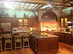 Rayna James' Kitchen. I like the glass cabinets with cream interior & lights in them.