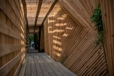 French Studio Atelier Vecteur Completes Oscillating Timber Tunnel http://parisdesignagenda.com/french-studio-atelier-vecteur-completes-oscillating-timber-tunnel/ #design #timber #woodworking #garden #wooden