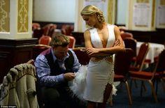 Nip and tuck: Latin Ballroom World Champion Yulia Zagoruychenko is pictured during a fitti...