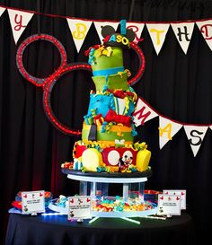 An Incredible Mickey Mouse First Birthday Party inspired by the clubhouse! with edible centerpieces, balloon sculptures and a fabulous candy bar + more!