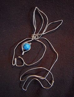 Rabbit wire sculpture with stone