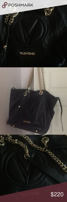 Valentino purse Like new black leader Valentino purse-handbag 12 in width and 12 high. Can open to 19 in on top. Golden hardware and 28 in golden and leather Valentino Accessories