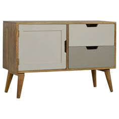 This is a handcrafted solid wood cabinet with 2 painted drawers and cupboard. It is painted in shades of off white and grey with cut outs for opening and closing.  They have short Scandinavian style tapered legs    * 100% Solid Mango Wood  *  2 Drawers  * Cupboard  * Painted Fronts  * Crafted By Hand  * Legs Detached for Delivery  * Natural Wood Finish  * Secure Packaging  * Timber EU Compliant  Important Note:  This listing do...