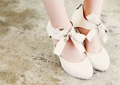 Heels. Bows. Girly. I'm never going to be taken seriously, am I?
