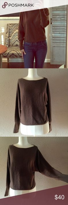 Bloomingdales 100% Cashmere dolman sleeve sweater Soft 100% Cashmere boatneck crop sweater in soft brown features full length dolman style sleeves, banded trim at Dolman sleeves Contemporary relaxed fit Length: 21'' from shoulder seam to hem. In excellent used condition. Dry cleaned. Bloomingdale's Sweaters