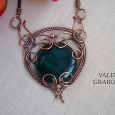 Round pendant with green chrysoprase in boho metalwork style , copper wire wrapped by handmade.  Jewelry patinated, polished and lacquered to protect finish.  The size of the pendant - 8cm* 7 cm (3.15 x 2.75 inches). Cord length of any caoutchouc . Just write me about it.