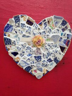 A one off hand made Heart Mosaic made in the style of Pique Assiette made from antique plates and saucers, beach combed finds and vintage bone chins fl;wers. The pieces are all secured to wedi boards with strong tile adhesive and finally grouted and polished all by hand. The hearts all weigh
