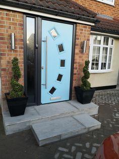 composite door in duck egg blue, silver grey indain stone step. Composite Door, Duck Egg Blue, Landscaping, Garage Doors, Stairs, Stone, Grey, Building, Outdoor Decor