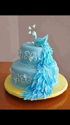 Cute peacock cake for a baby boy shower