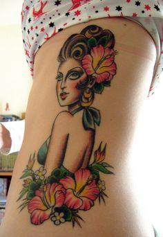 Hula girl Hawaiian tattoo design with hibiscus flowers