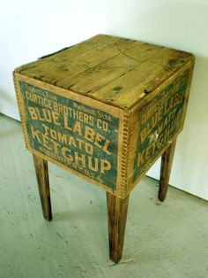 This vintage Blue Label Ketchup advertising crate side table is awesome! Made in Tennessee, the antique crate sits snugly, via gravity, atop the custom leg assembly and can be readily removed without harming the crate. Labeling graphics appear on all four sides of the one-of-a-kind table.