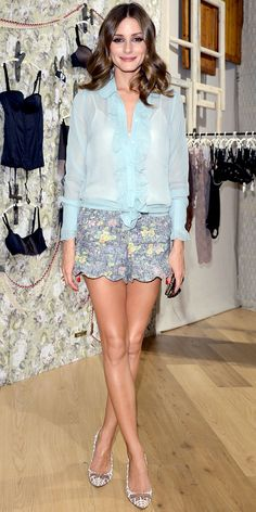 Palermo took in the Intimissimi collection in the label's sheer blouse, scalloped shorts and a pair of printed pumps.