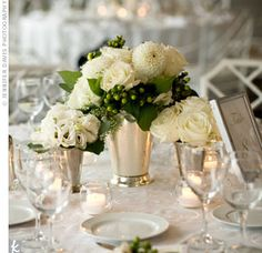Silver mint julep cups held garden roses, freesias, dahlias and hydrangeas for a classic, elegant effect.