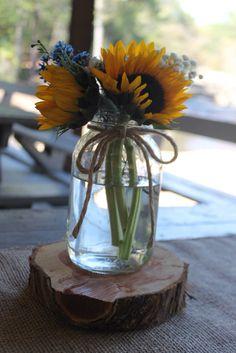 Costley mill park, Conyers ga. Hydrangeas, sunflowers, blue wax flower. EMW florals, monroe GA. Wedding garland and shotgun shells, centerpieces.