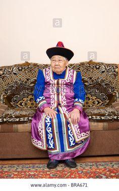an elderly buryat (mongolian) woman of ninety years, in a national costume Stock Photo