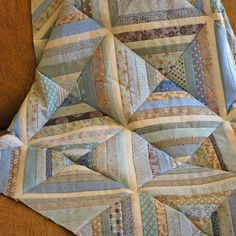 Miracle of miracles! I sat down to sew a few Sea Glass blockstogether on Sunday and before I knew it I had the entire top together, so I...