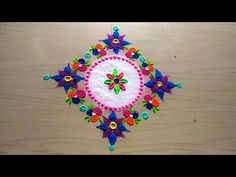 How to make easy and simple/unique rangoli designs by Jyoti Rathod - YouTube