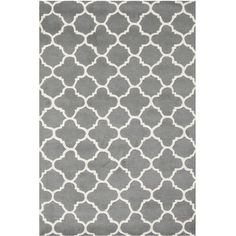 Add a pop of pattern to your foyer or den with this hand-tufted wool rug, featuring a quatrefoil motif in dark grey and ivory.   Product...