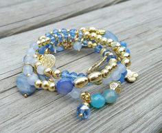 Check out this item in my Etsy shop https://www.etsy.com/listing/260247134/set-of-4-blue-and-gold-beaded-bracelets