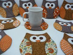 Owl Mug Rug - Owl Coasters These cute little owl mug rugs are both fun and functional! Theyll definitely add some cheer to your home or office, and are great gifts!  Mug Rugs shown feature brown bodies and orange wings. Please select from options to choose a body color for your mug rugs, and a color or holiday fabric for the wings. Size: 5.5 x 5.5  Custom orders welcome.  Handmade in my smoke free/pet free home.  International Customers ordering 2 or more mug rugs: Please let me know how…