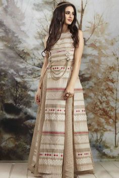 A lovely checkered beige skirt looks fetching in combination with the ivory & beige over layer printed in the infamous cultural prints. Buy Designer Suit online - http://www.aishwaryadesignstudio.com/designer-suit-readymade