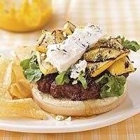 Burgers topped with goat cheese, yellow summer squash, and red wine vinegar-thyme-olive oil dressing.