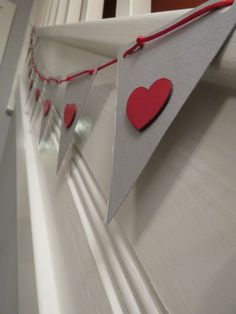 Paper bunting with wooden hearts