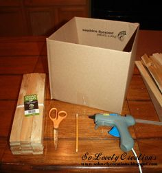 Super+easy+idea+to+turn+a+simple+cardboard+box+into+a+beautiful+wooden+box! Materials:+Cardboard+Box+-+Cedar+Shims+-+Scissors+-+Pencil+-+Glue+Gun+-+Clear+Tape+(…