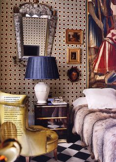^ Love  number of things about this room.  Fur, color, mix of styles and textures, black and white floor, gold frames.