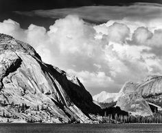 1946 Tenaya Lake, Mount Conness, Yosemite National Park [dome mountain at left, others in right distance; thick clouds, lake at bottom of image] by Ansel Adams 77.65.16