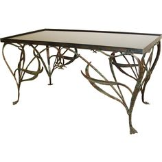 Art Nouveau Style Wrought Iron Coffee Table. | From a unique collection of antique and modern coffee and cocktail tables at https://www.1stdibs.com/furniture/tables/coffee-tables-cocktail-tables/
