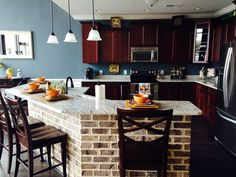 Love this kitchen's design & decor! Adorable Charleston kitchen w.brick island w.granite & marble countertops by #RealDealCountertops