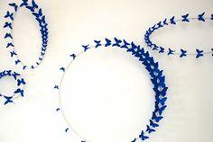 Artist Paul Villinski created wall decoration butterflies cut from beer cans.