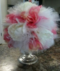 Feather and tulle arrangement my mom made for Addie's birthday party