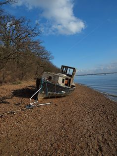 Photo of a wrecked cabin cruiser on the banks of the Medway river Kent at Lower Upnor, one of my fav places for a walk tide allowing