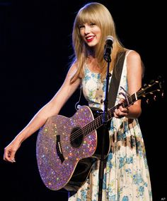 Grammy award winning artist Taylor Swift performs during the Walmart Stores Inc. shareholders' meeting in Fayetteville, Ark., Friday, June 1, 2012.