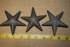 Texas Farmhouse Carriage House Garage Door Hardware Accents, Rustic Cast Iron Star Nails 3 inch, Volume Priced by WePeddleMetal on Etsy Faux Wood Garage Door, Garage Door Hardware, Carriage House Garage Doors, Carriage Doors, Shelf Brackets Rustic, Stars Nails, Old Fashioned Key, King Nails, Cast Iron