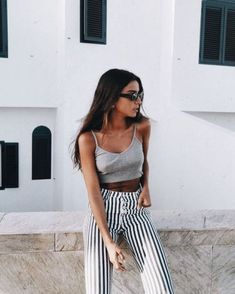 I love this black and white look for summer with high waisted striped pants! #stripedpants #stripedpantsoutfit #stripedpantsoutfitwork #stripedpantsoutfitsummer