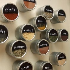 DIY magnetic spice storage by small::bird, via Flickr...I really like this idea:  Containers (2oz., deep)  Magnets  Chalkboard contact paper  Chalkboard pen (fine tip)
