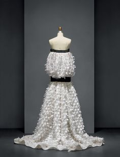House of Dior (French, founded 1947). Raf Simons (Belgian, born 1968). Dress, spring/summer 2014, Haute Couture. Machine–sewn white silk mousseline with hand–embroidered cutwork and appliqué of hand–cut black silk chiffon and white silk embroidered flowers, hand–embroidered with red beads. Photo © Nicholas Alan Cope. #ManusxMachina #CostumeInstitute
